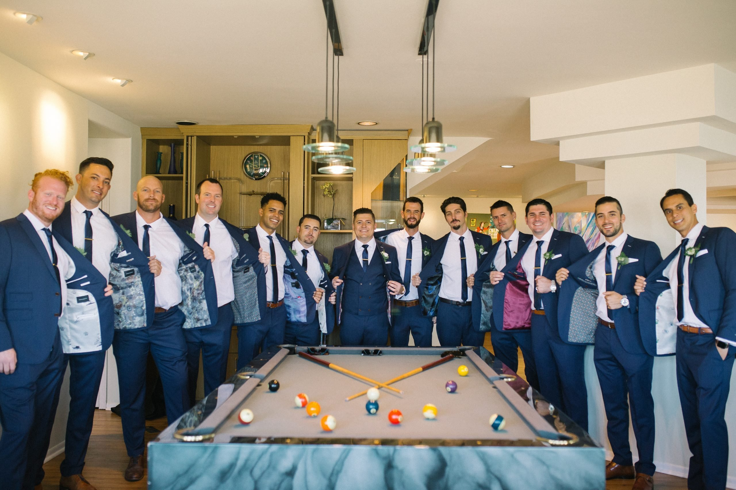 Groomsmen Dressing Up with Custom Suits
